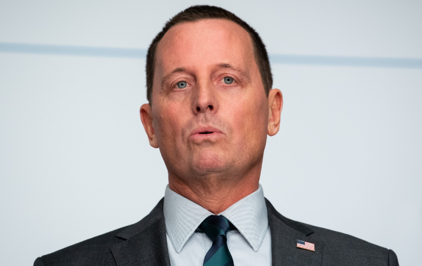 Close-up image of Richard Grenell speaking.