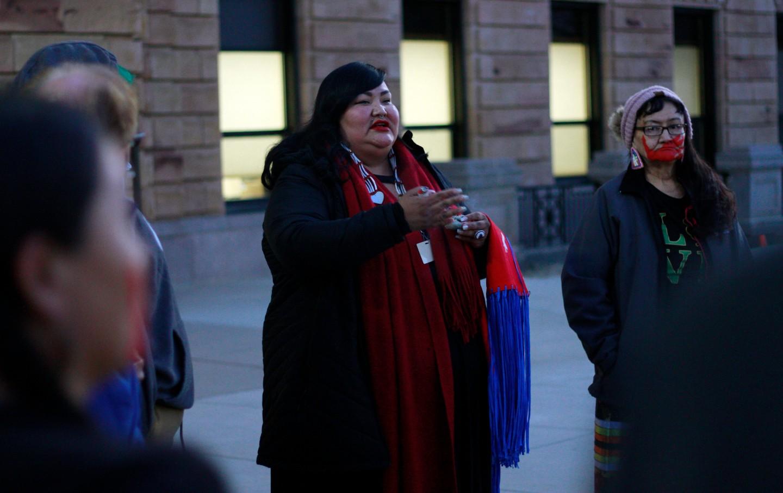 Candi Brings Plenty prays outside SD capitol