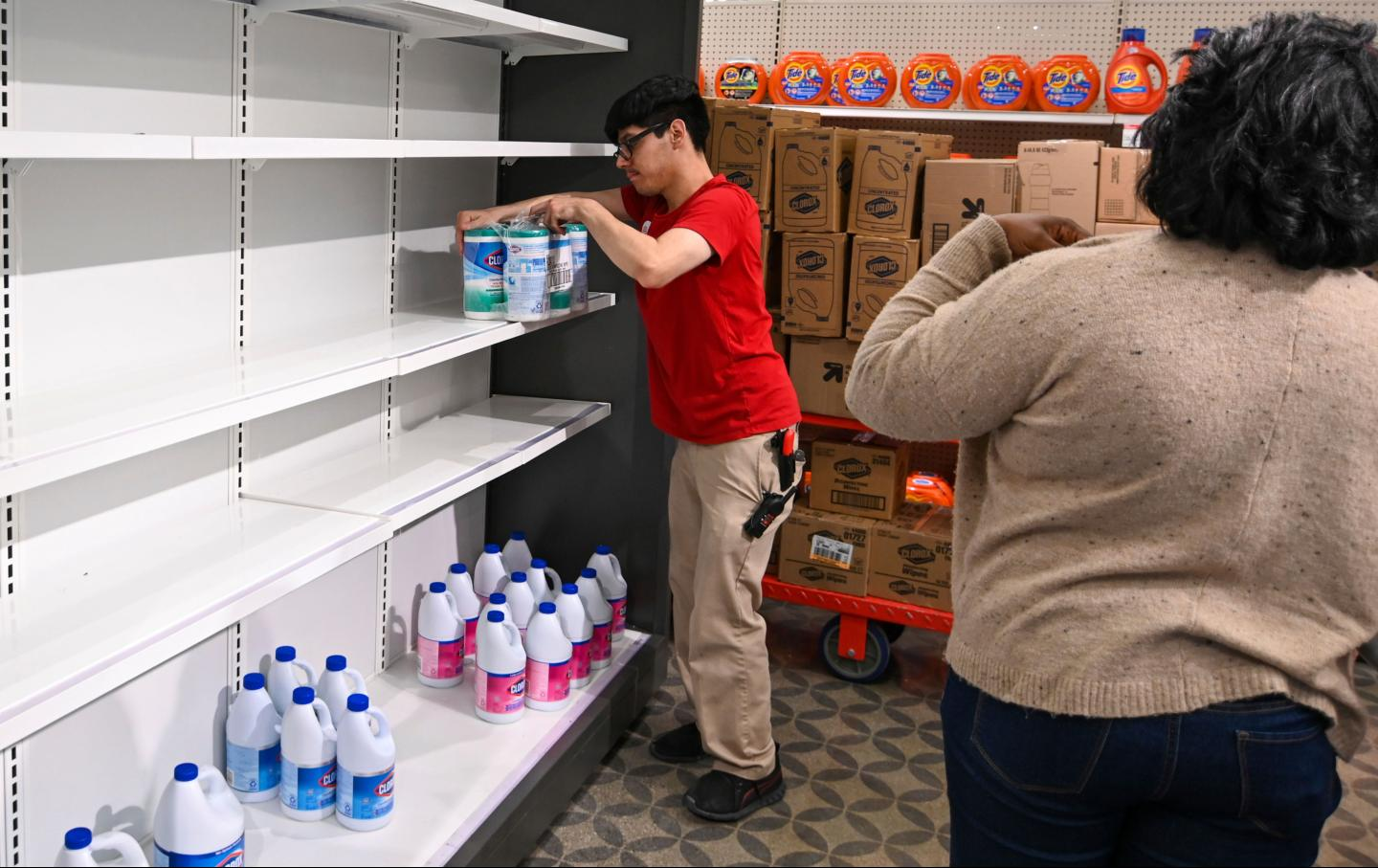 A target worker stocks goods at a store in Riverside, California