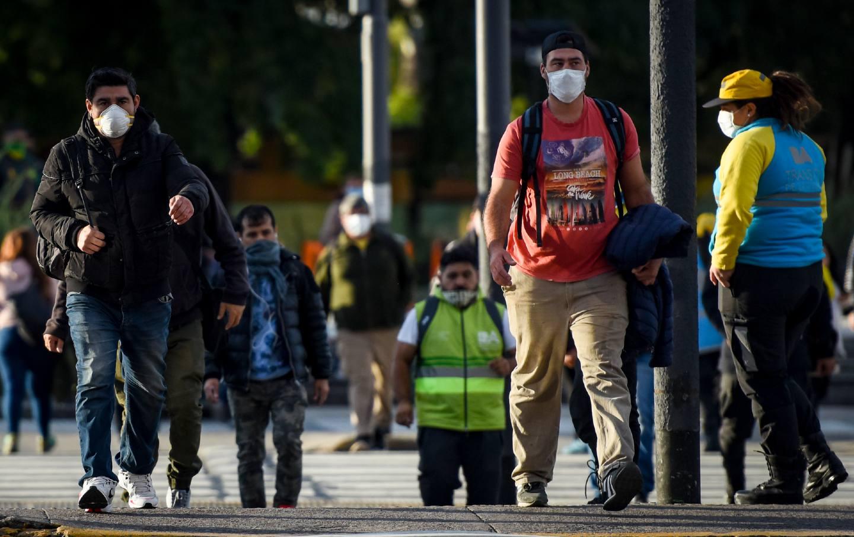 Pedestrians wear face masks while walking