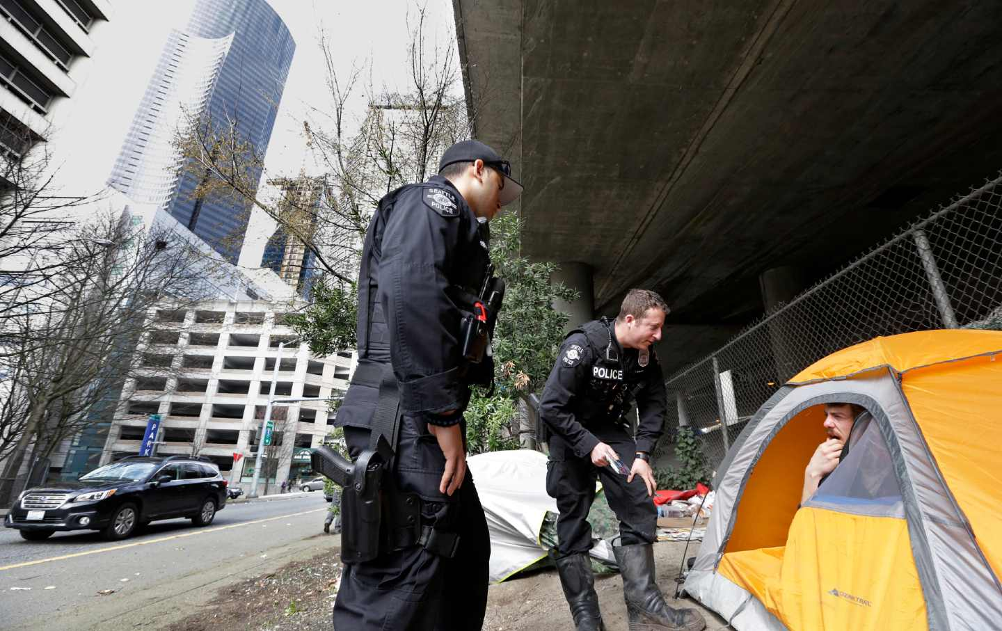 Seattle cops with homeless man