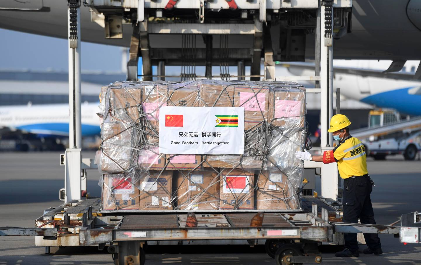 Chinese worker loads medical supplies to Zimbabwe