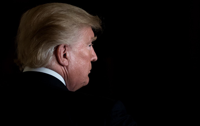 trump-headshot-profile-black-background-gt-img