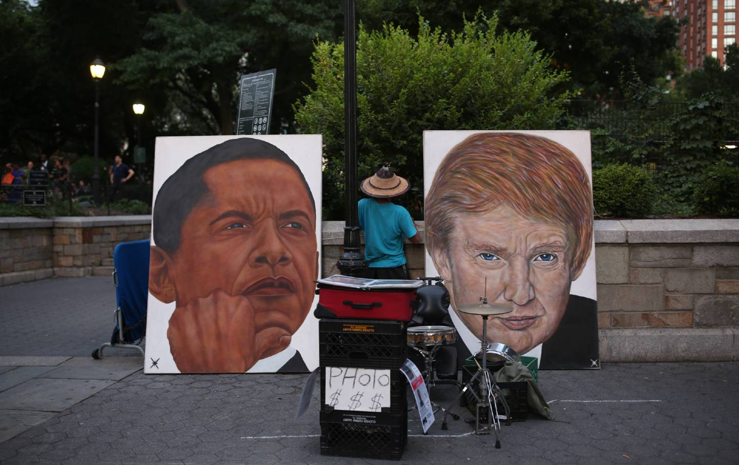 Paintings of Donald Trump and Barack Obama's faces are displayed outside a park in New York CIty