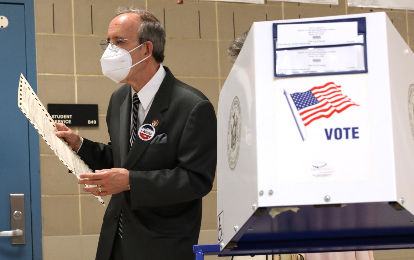 Eliot Engel walks past a voting booth