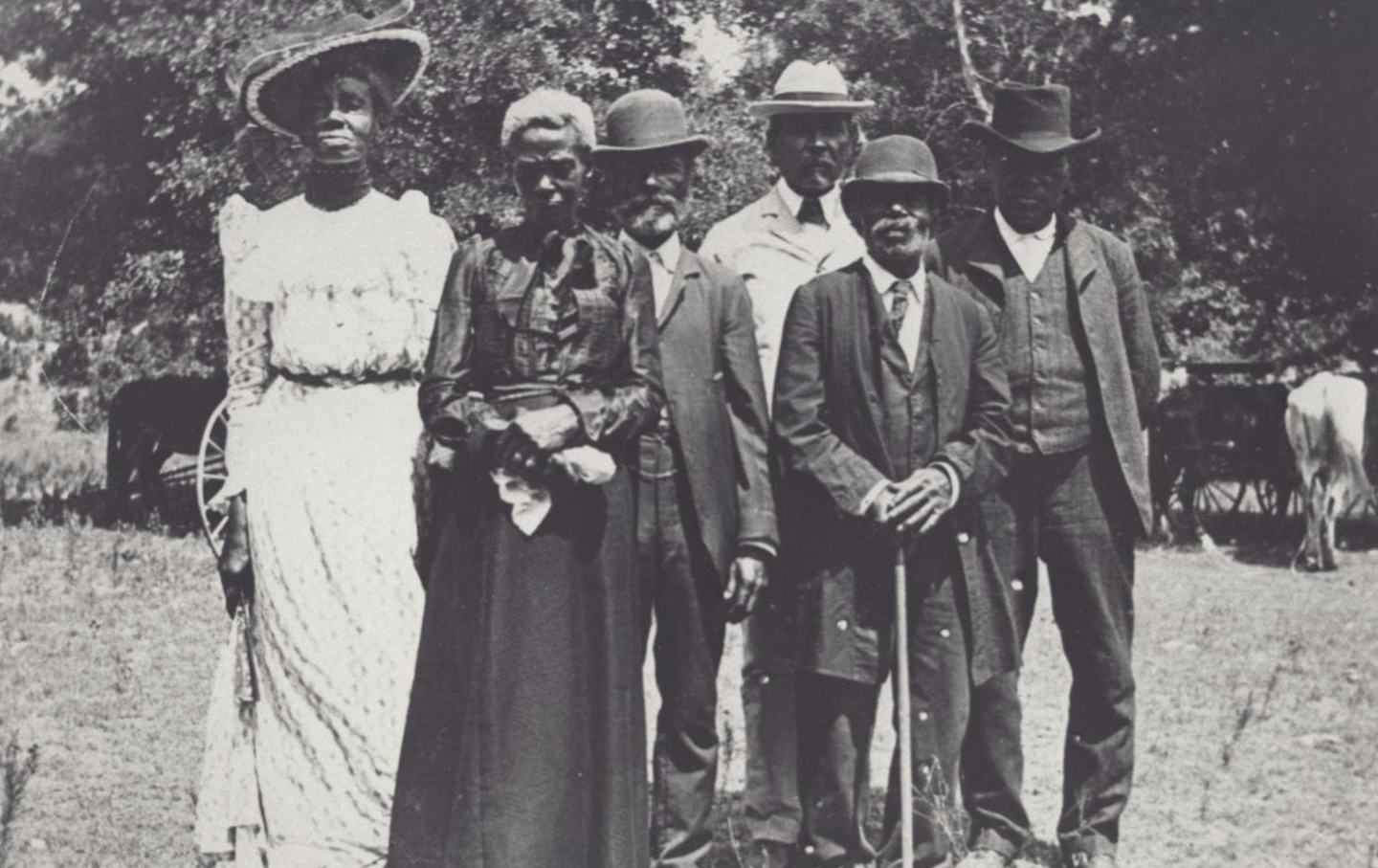 Black men and women dressed for an emancipation day celebration in Texas