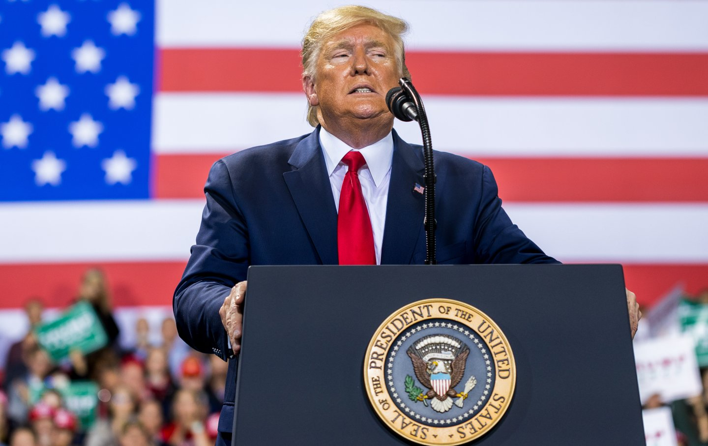 Trump in front of an American flag