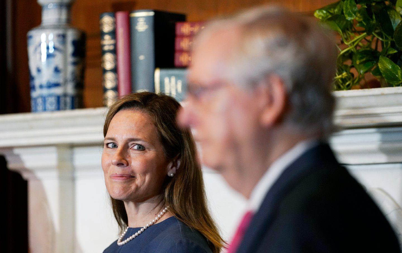 Amy Coney Barrett watches Mitch McConnell speak