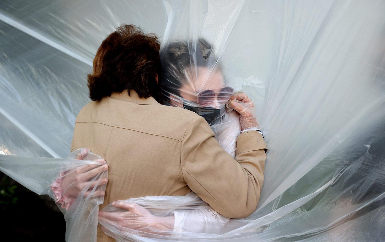 coronavirus-grandmother-hug-plastic-gty-img