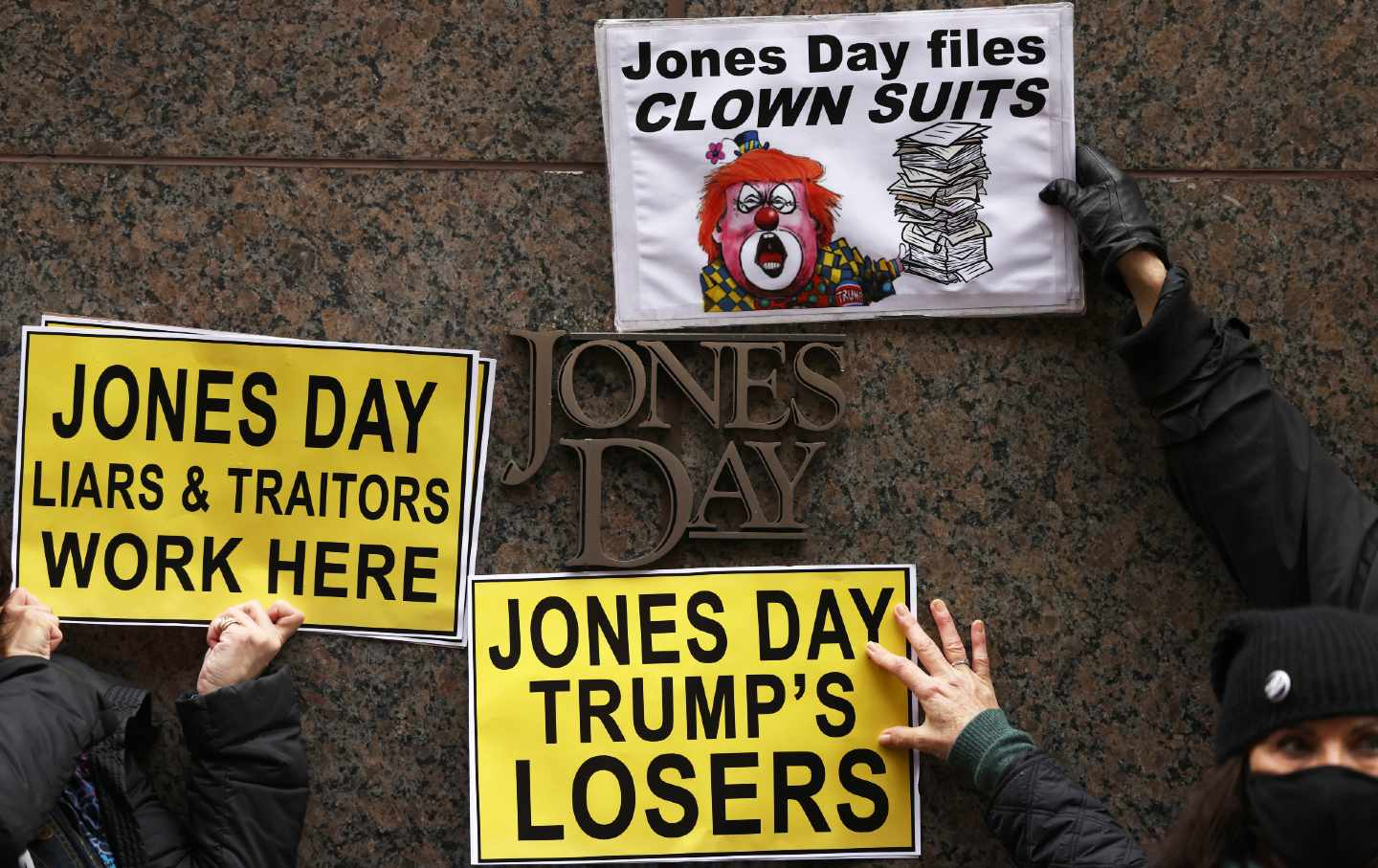 Protest signs in front of Jones Day office