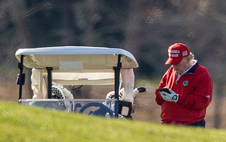 trump-golf-cart-phone-gty-img