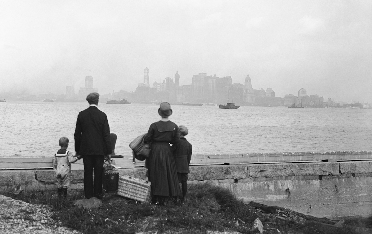 Immigrant Family Looking at New York Skyline