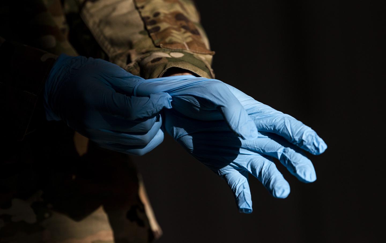 military-uniform-gloves-covid-testing-gty-img