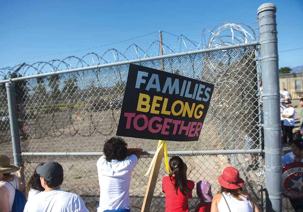 Demonstrators rally outside a detention facility