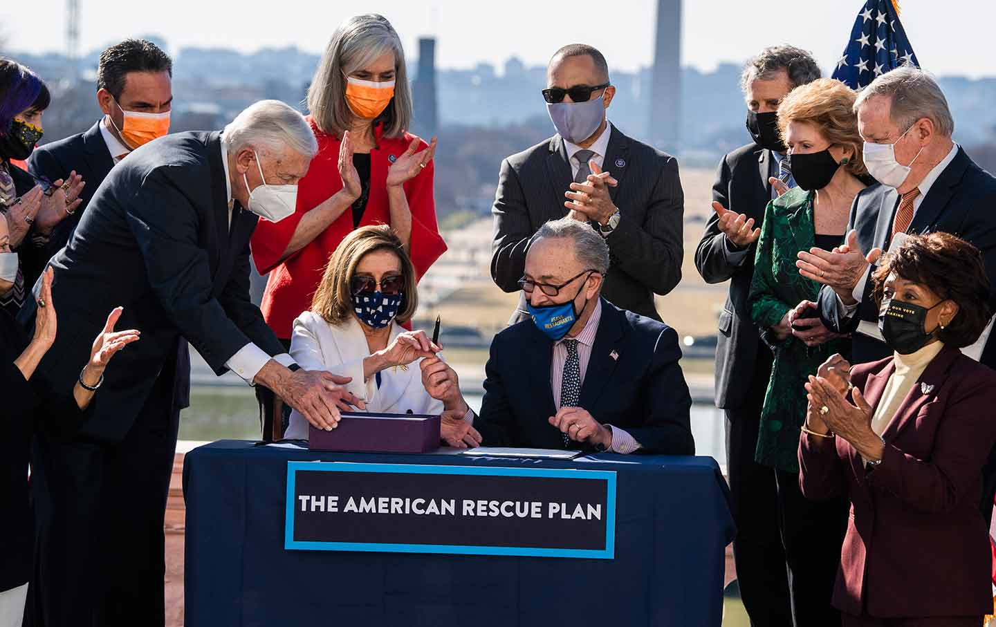 Speaker Nancy Pelosi and Majority Leader Chuck Schumer sign the American Rescue Plan Act.
