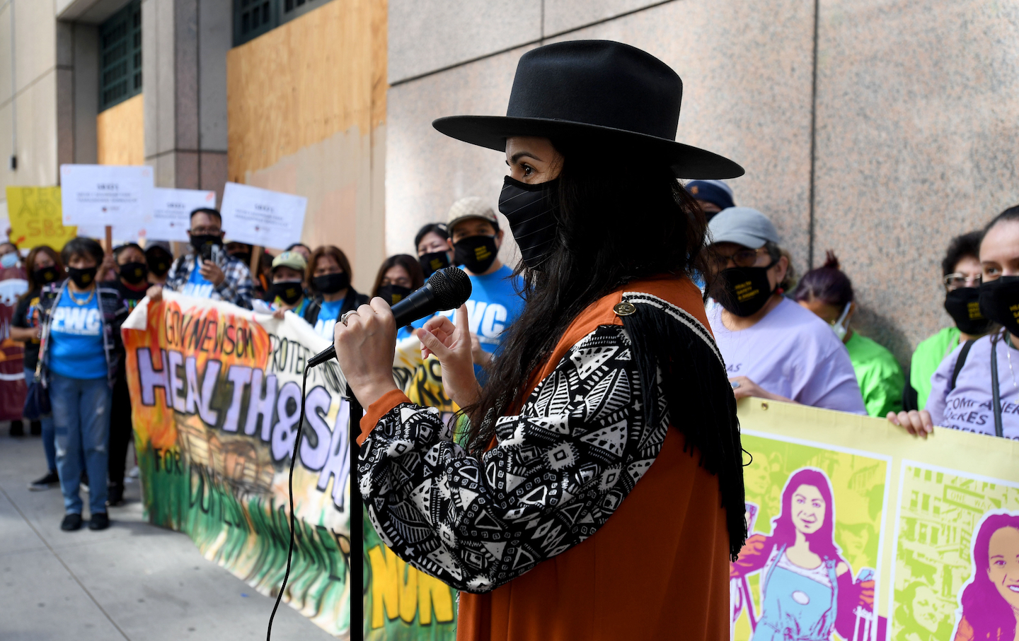 Domestic workers hold rally for health and safety protections.