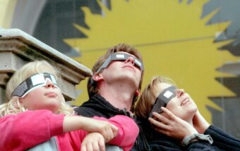 A family watches the solar eclipse in Germany, 1999.